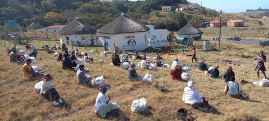 Nomonde explaining the Masifunde Activity book