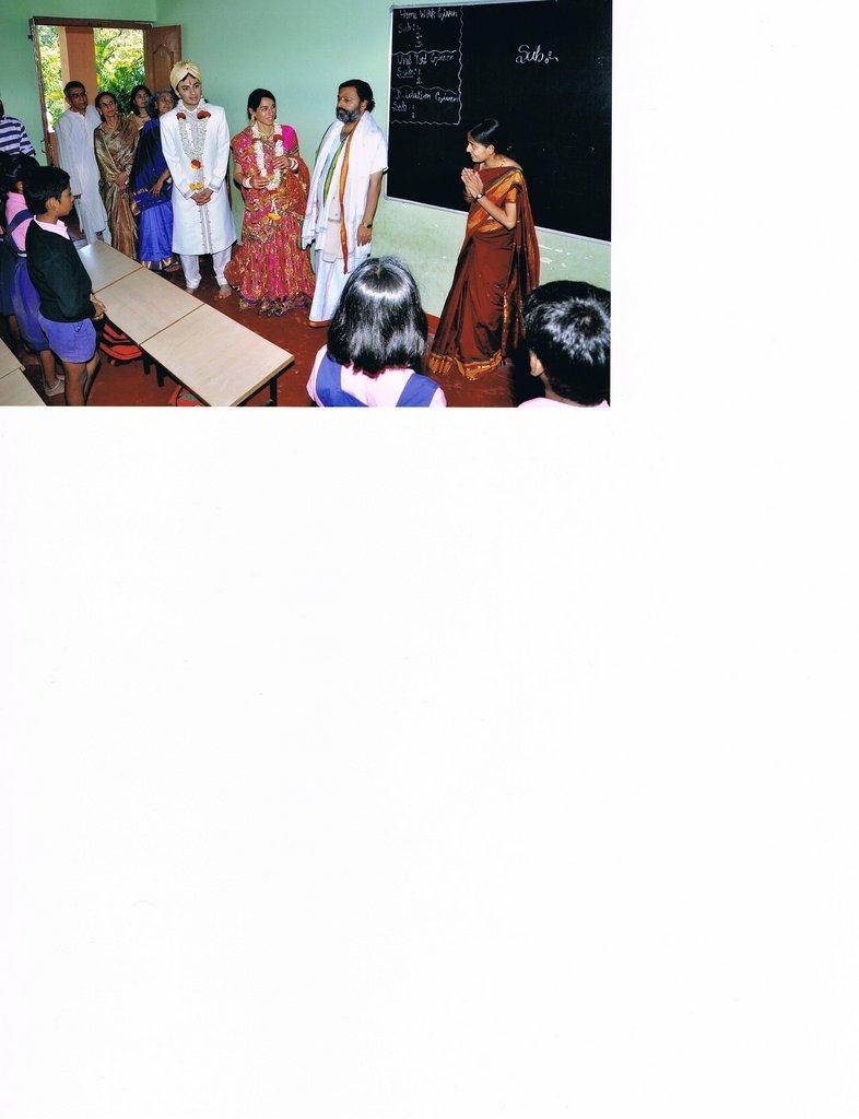 Charu, Salil with Guruji in a classroom