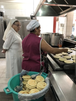 Making Arepas at the school kitchen