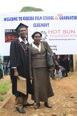 Erasto and his grandma at graduation