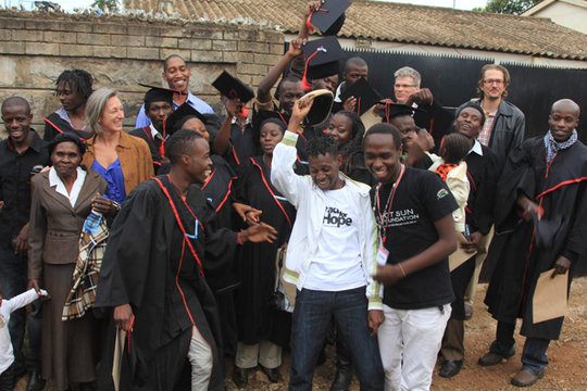 Wilfred celebrates with 2012 Graduating class