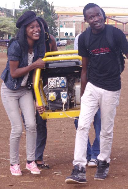 Kibera Film School trainees carry equipment