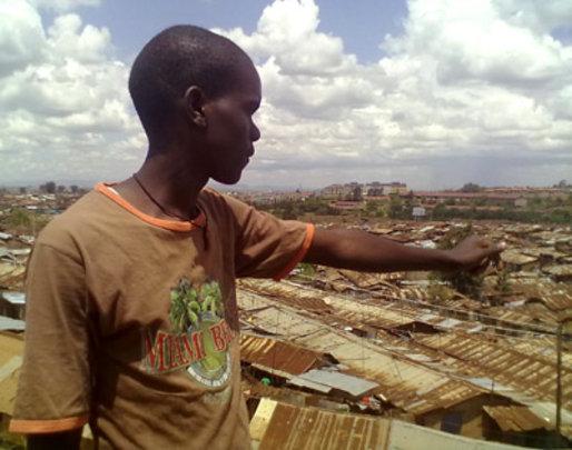 Ignatius pointing to Kibera, where he lives