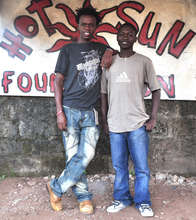 Josphat and Vincent at Hot Sun Foundation office