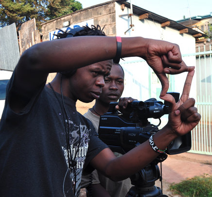 Josphat assisting Vincent during filming