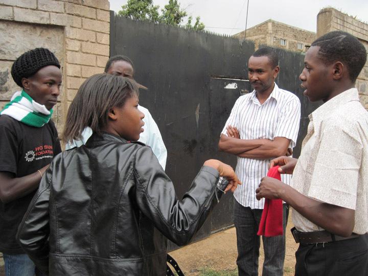 Ian Mbugua watching students rehearse