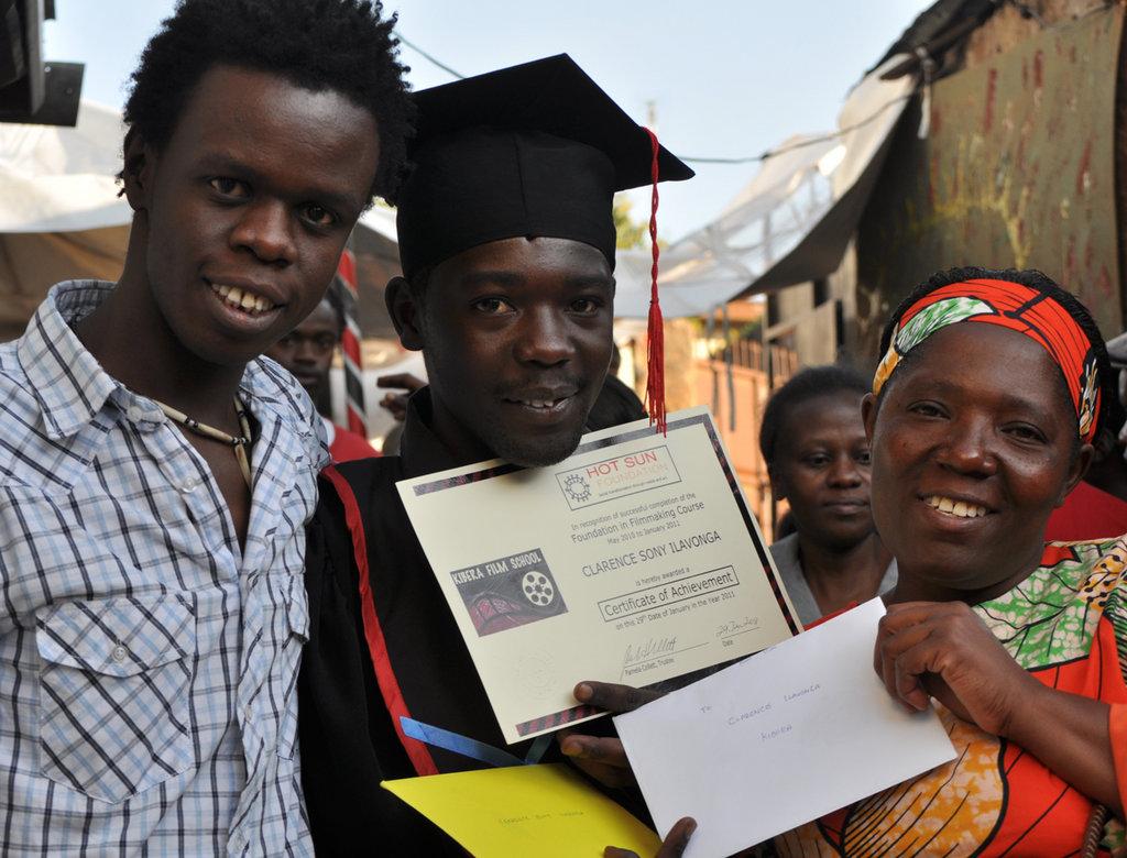 Josphat Keya with KFS graduate Clarence Ilavonga