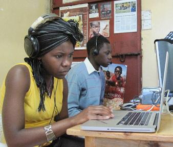 Martha Kisaka and Wilfred Masea editing their projects
