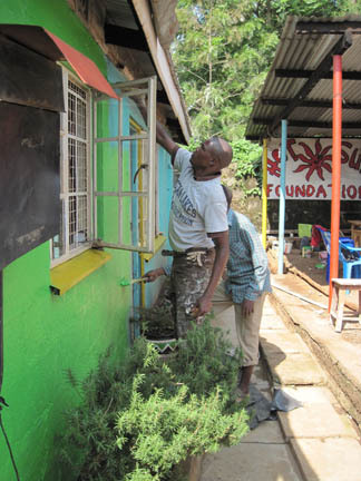 Painting the NEW Hot Sun Foundation office in Kibera