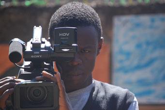 Josphat Keya filming his project at Kibera Film School