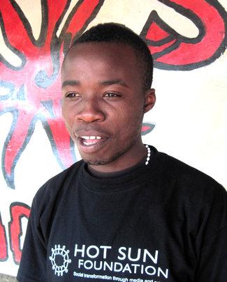 Ronald Omondi outside Hot Sun Foundation office