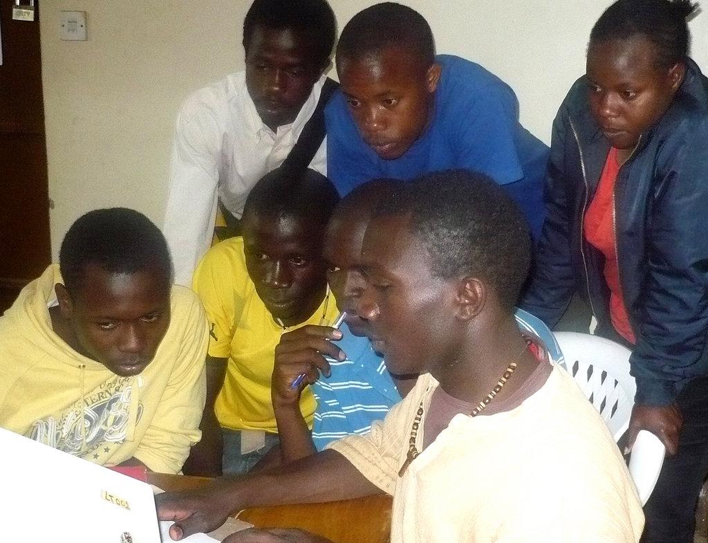 Kibera Film School trainees learning editing