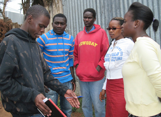 Trainees discuss script at KIBERA FILM SCHOOL