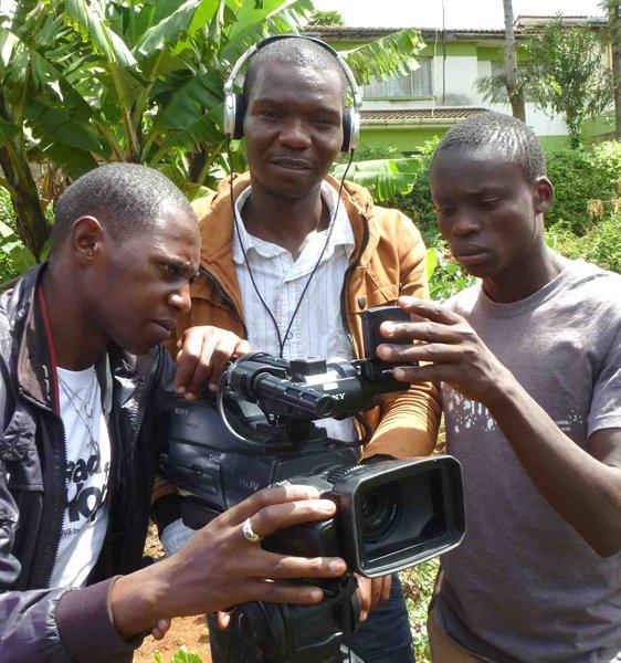 Sammy, center, with Film School grads now trainers