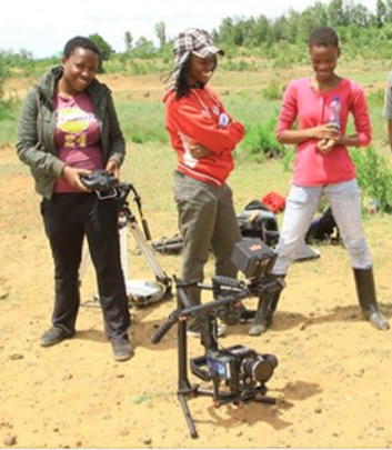 Grace with Hot Sun Foundation trainees on location