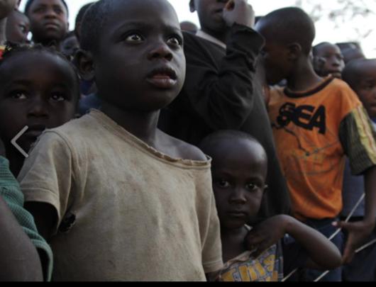 Children watching Slum Film Festival entertainment