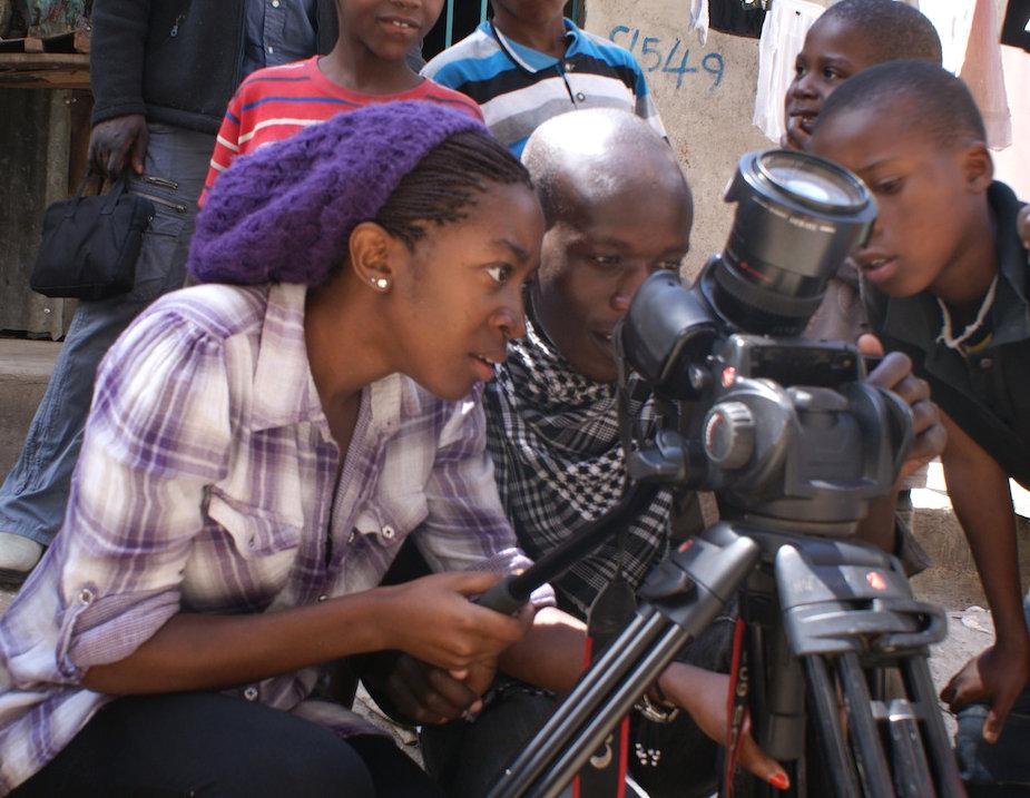 Shirley and Joash, filming in Kibera