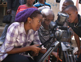Shirley and Joash, filming in Kibera