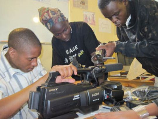 Trainees learning about their new camera