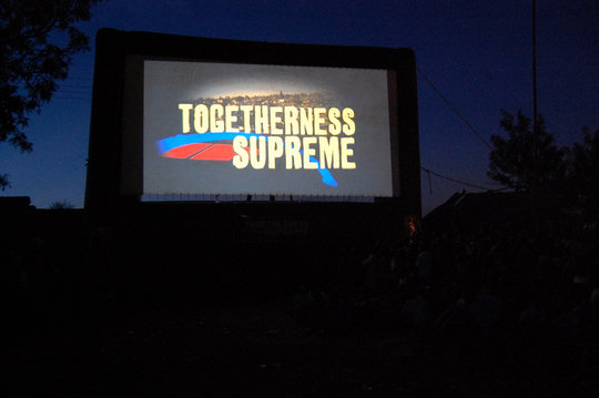 TOGETHERNESS SUPREME  outdoor screening in Kibera