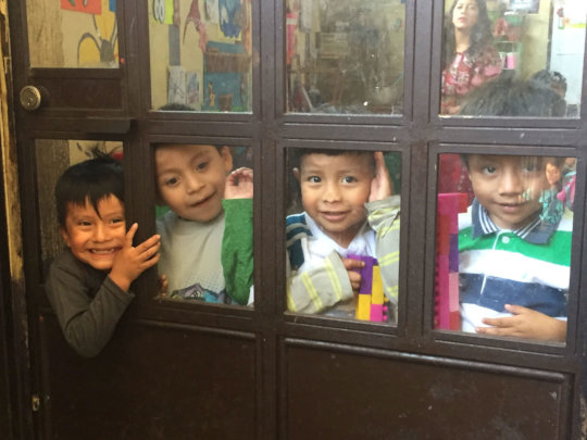 Children are excited to have visitors at school.