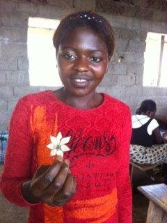 A Trainee displaying the flower she produced