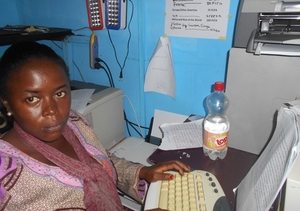 Linda on Desk at the Center