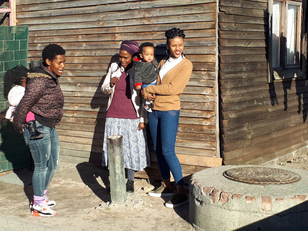 Khanyisa Reading parter at home with family