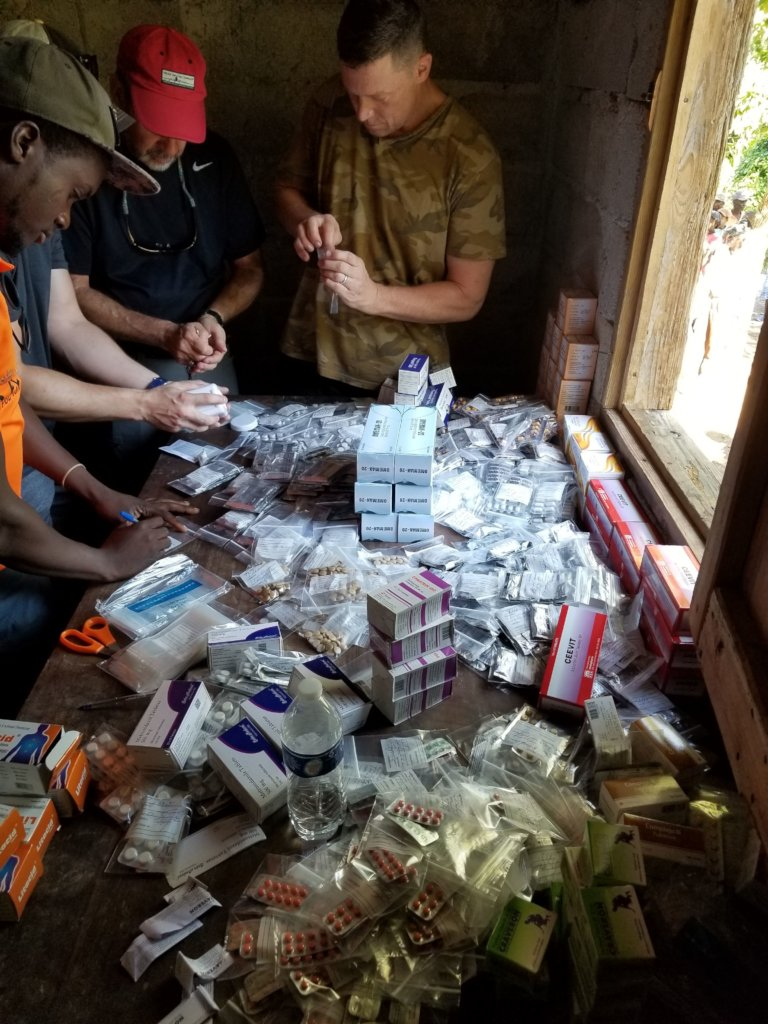 Volunteers and H.O.P.E. staff sort medication