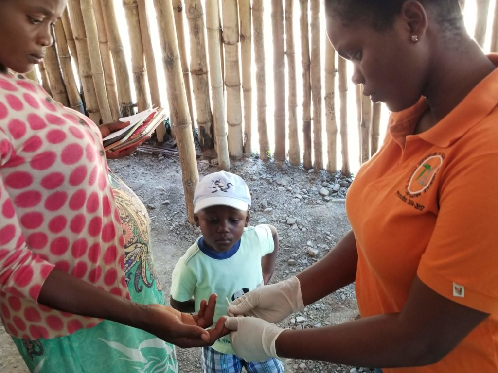 A pregnant mother and her son receive treatment