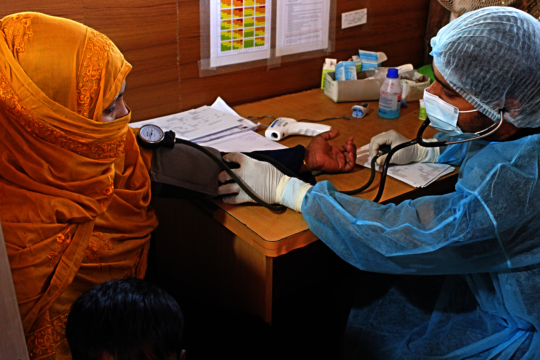 IRC paramedics screening Sakera in triage section.