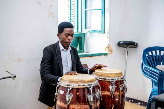 DCMA student practices the drums.