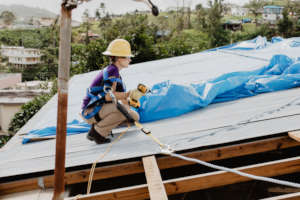 A volunteer working on a roof in Puerto Rico