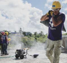 Volunteers doing concrete work