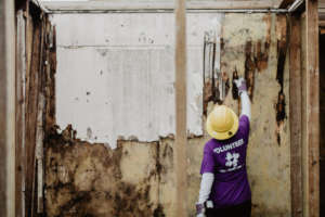 A volunteer assesses the damage