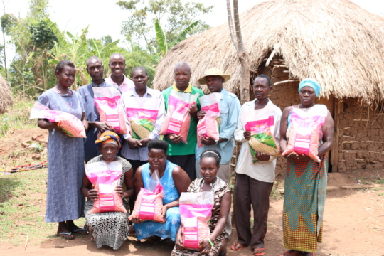 Men and Women after receiving seeds for planting