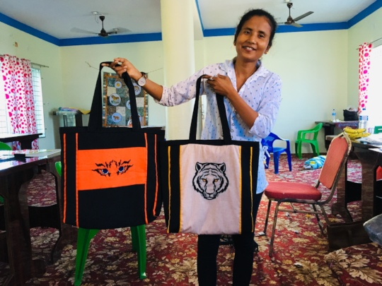 Sarita with finished tiger bags