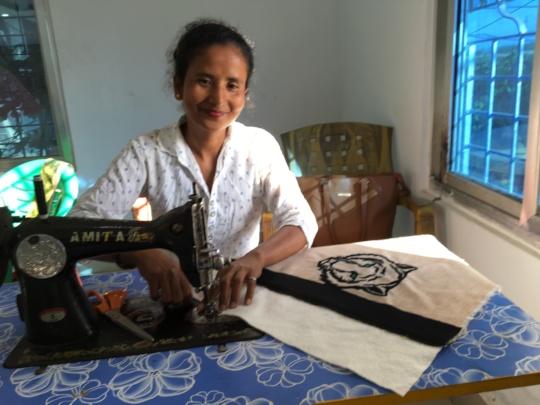 Sarita, hard at work on a new tiger bag