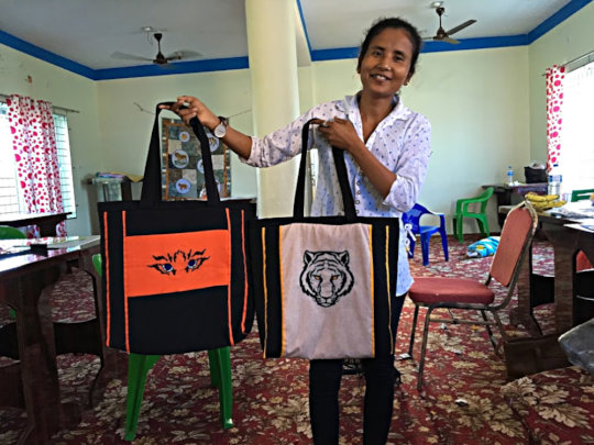 Top on the line: Sarita with two of the new bags