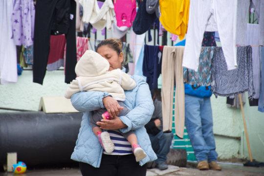A mother awaits asylum at the U.S. Mexico border