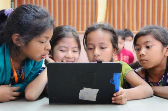 Students use the RACHEL program on a tablet