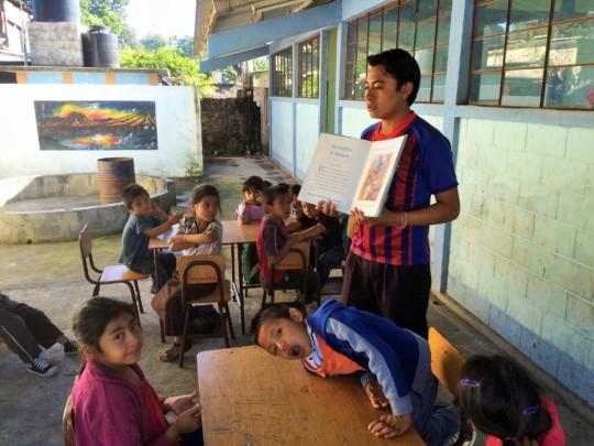 School librarian, Julio, reads to the children