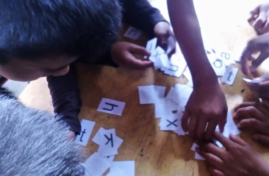 Students learning the alphabet