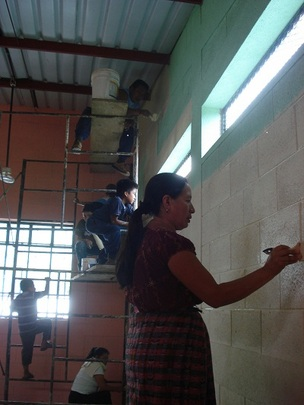 Teacher Painting the Library