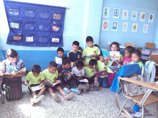 Students crowding around a mini-library