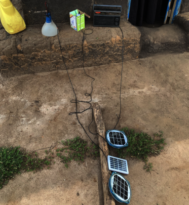 Refugees charge light and radio with solar panels