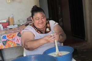 Dalila making cheese