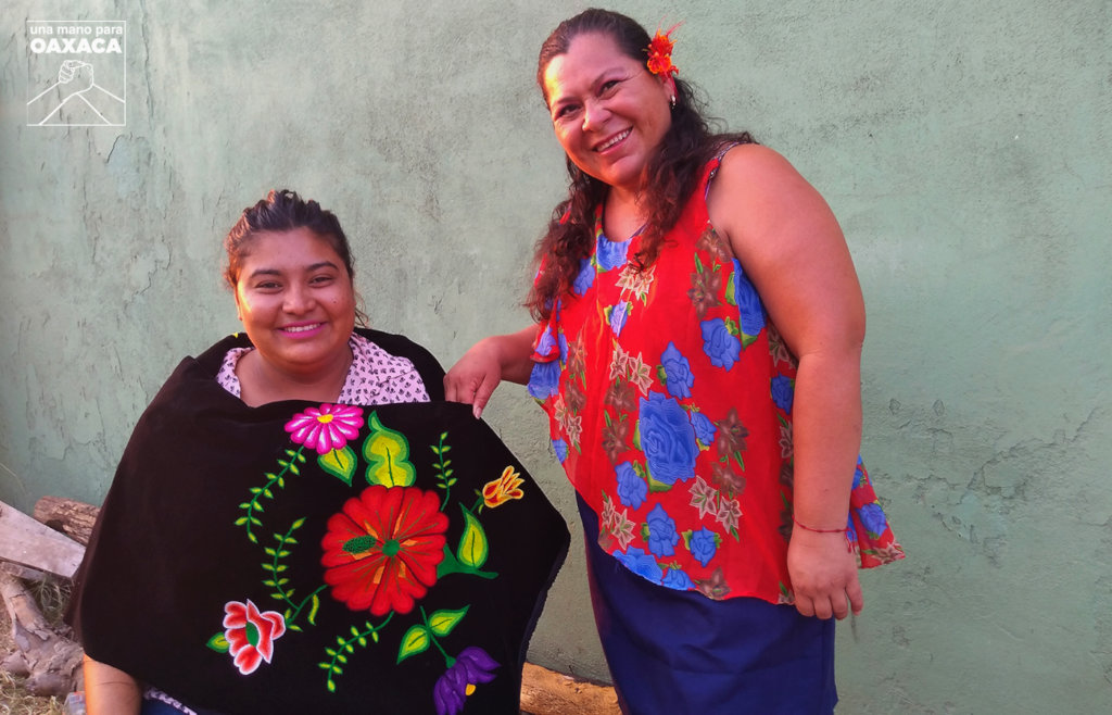 Iris and Rosa, embroidery and dress made by them