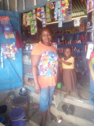 Mabel and her daughter in her shop.