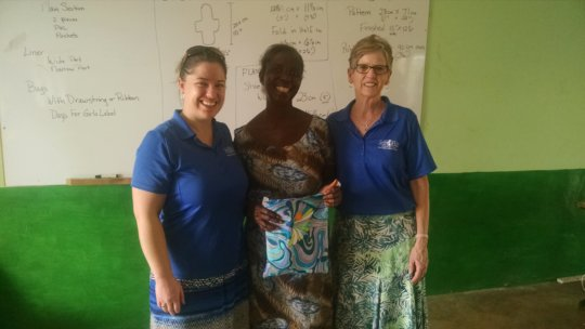 Nora (L) and Gail (R) present Olivia with a prize